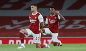 Arsenal's Gabriel Magalhaes takes the knee in support of Black Lives Matter.