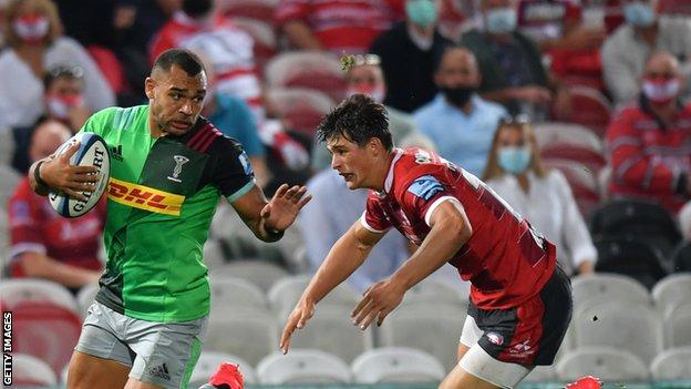 Harlequins centre Joe Marchant evades the tackle of Gloucester winger Louis Rees-Zammit during a Premiership match at Kingsholm