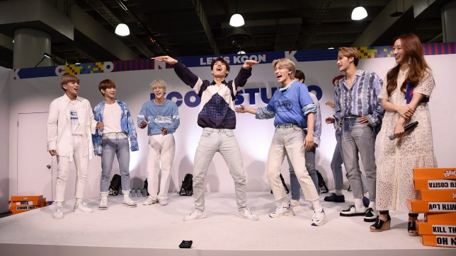 NEW YORK, NEW YORK - JULY 06: Jongho, Yeosang, Yunho, Mingi, San, Seonghwa of ATEEZ and Coco Lee attend the 2019 KCon New York at the Jacob K Javits Center on July 06, 2019 in New York City. (Photo by Steven Ferdman/Getty Images)