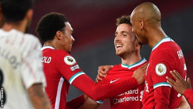 Diogo Jota celebrates with team-mates Trent Alexander-Arnold and Fabinho