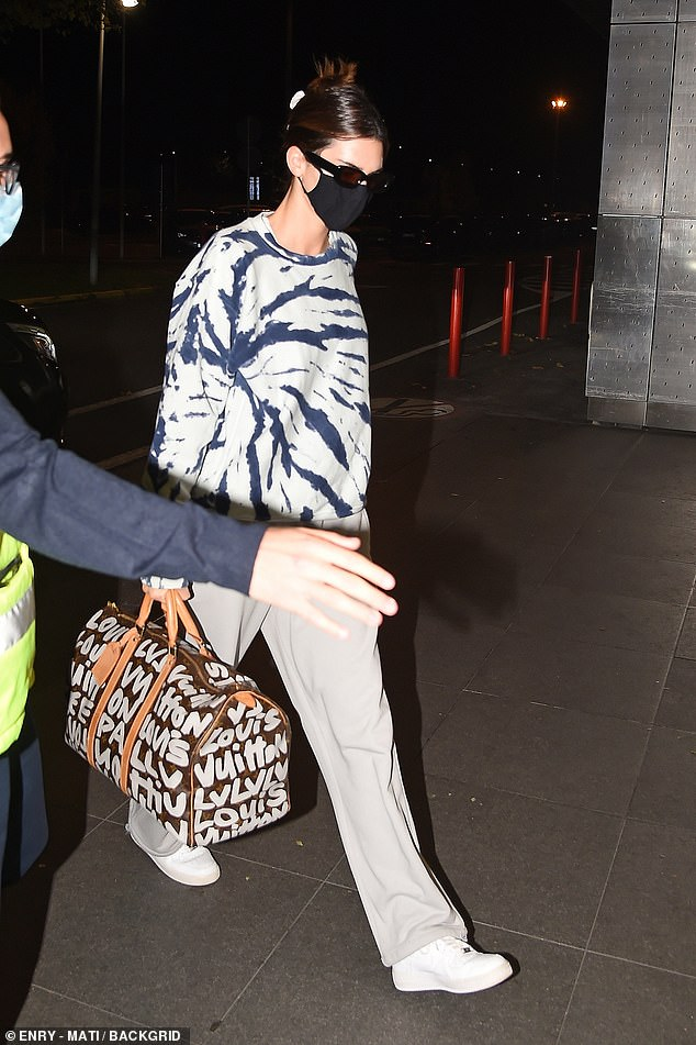 Departure: Dressing for comfort doesn't mean dressing down where a supermodel is concerned - as demonstrated by Kendall Jenner [pictured] and Hailey Bieber on Sunday night