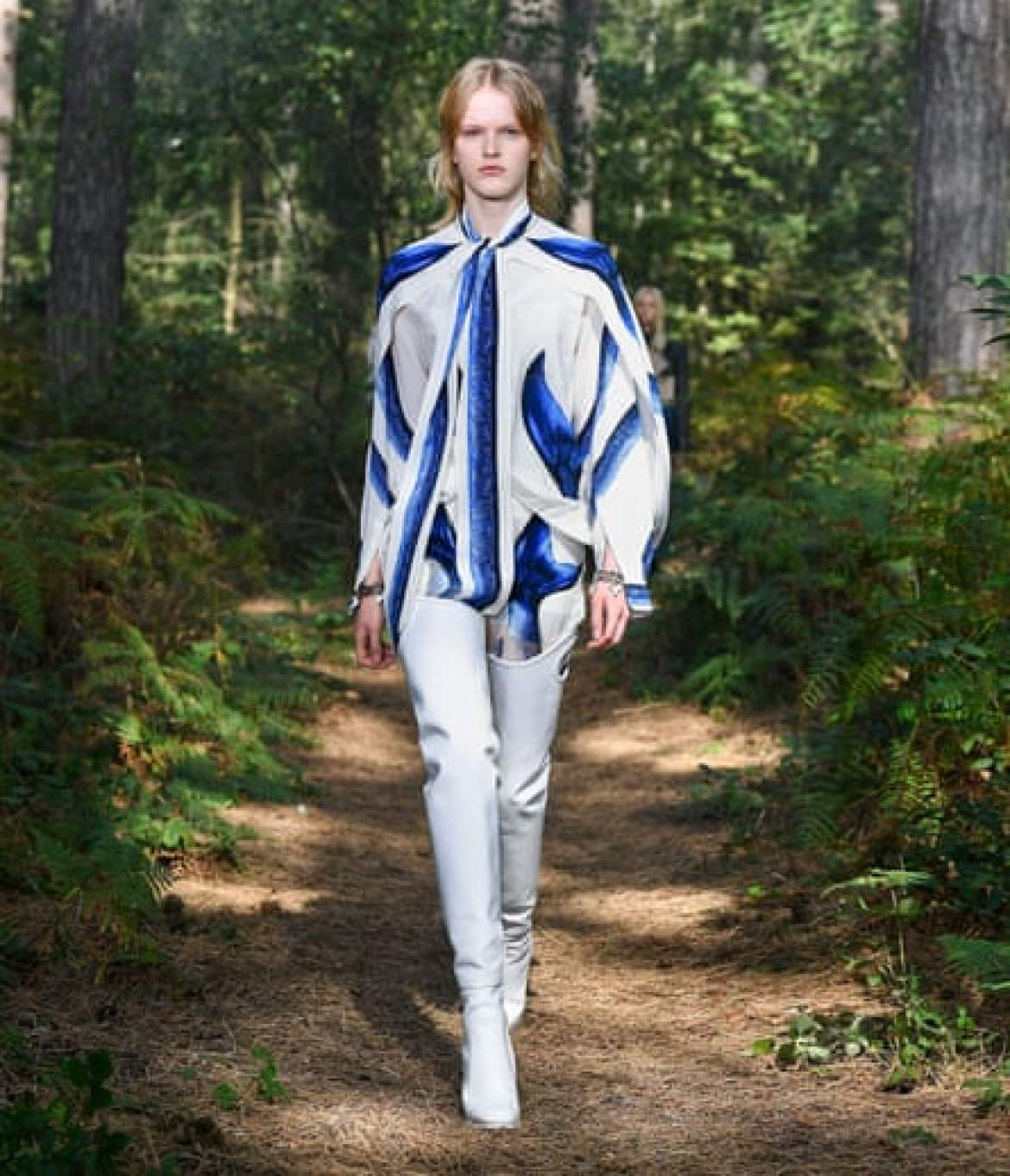 Blue and white shirt with tight white trousers