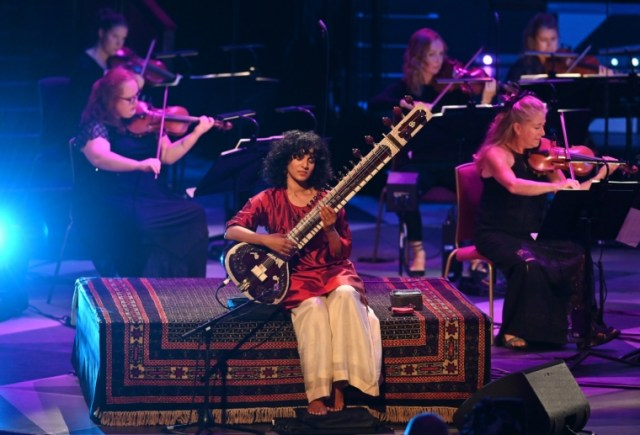 Prom 8: The Britten Sinfonia conducted by Jules Buckley are joined in a socially distanced performance by Anoushka Shankar and Manu Delago in the Royal Albert Hall without audience on Friday 4 Sept. 2020. Photo by Mark Allan/BBC Provided by sophie.eaton@bbc.co.uk