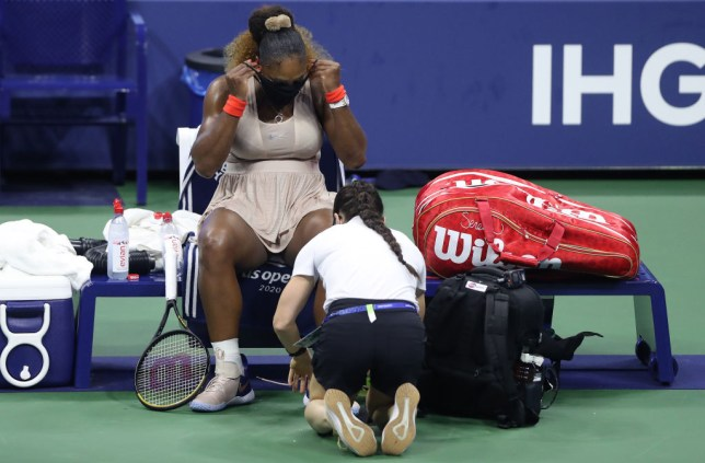 Serena Williams of the United States has her ankle retaped in the third set during her Women's Singles semifinal match against Victoria Azarenka of Belarus on Day Eleven of the 2020 US Open at the USTA Billie Jean King National Tennis Center on September 10, 2020 in the Queens borough of New York City.