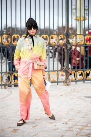Susanna Lau, wearing a colorful jumpsuit, Dior bag and black shoes, seen outside Dior, during Paris Fashion Week