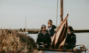 Skipper Zoe Dunford steers Saffron through the marshes.