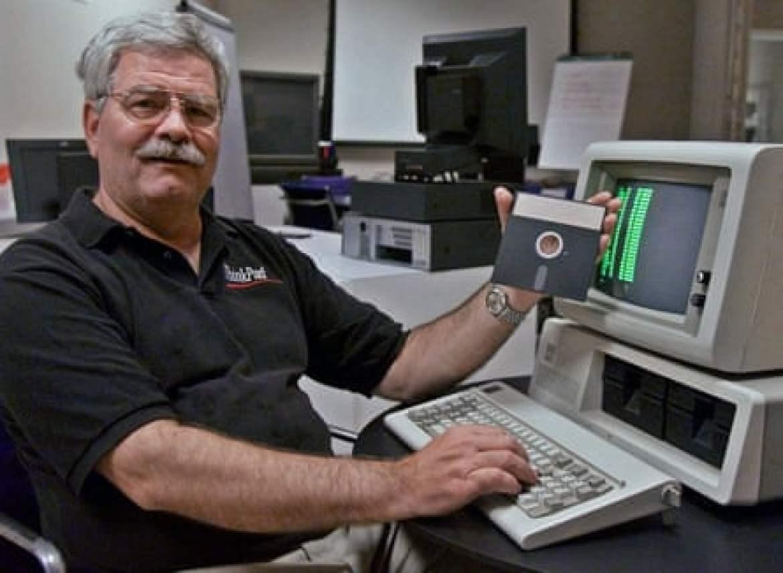 IBM developer David Bradley with a 5150 computer and DOS floppy disk.