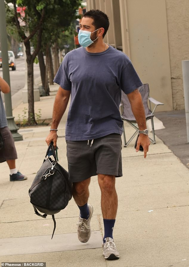 Perfect for moving: The 41-year-old actor covered up his muscular frame with a faded blue tee and a pair of grey basketball shorts