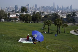 A group sits inside a circle designed to encourage social distancing at Dolores Park, San Francisco.