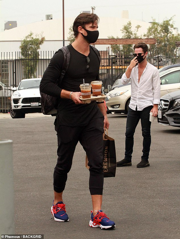 Caffeine fix: Her rumored partner Gleb Savchenko, 36, followed in tow with an Erewhon bag and two iced coffees in his hand