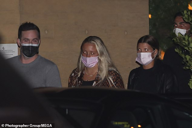 Mask mandate:She made sure to wear a face mask as she collected her car from the valet