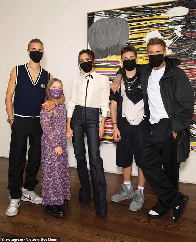 Sweet: The designer shared snaps of husband David, sons Romeo, 18, and Cruz, 15, and daughter Harper, nine, donning their face masks ahead of the digital presentation
