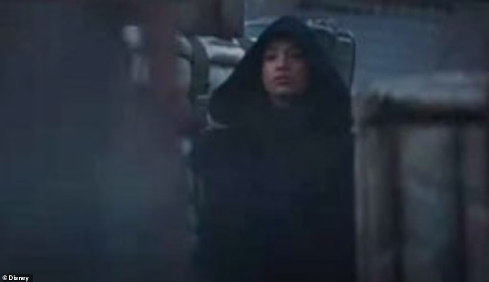 A quick look:A beautiful woman in a hood is seen in a crowded market place then she disappears suddenly, adding to the mystery. She is likely a member of the Jedi. This season two trailer for The Mandalorian is the first time the Jedi have been introduced and there promises to be much more of the guardians of peace