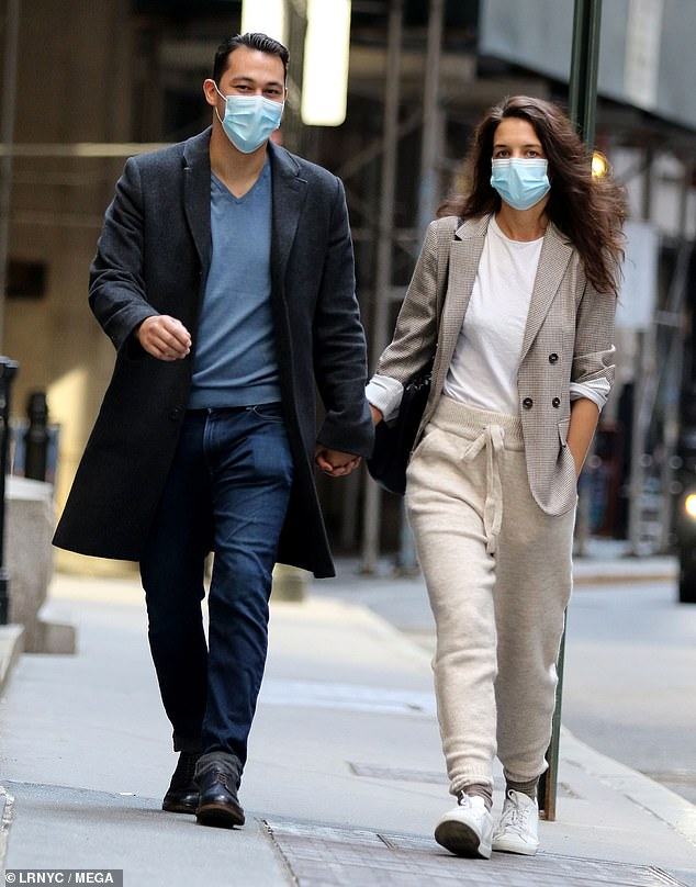 Hand-in-hand: At one point, the 41-year-old actress and the 33-year-old chef strolled with their hands interlocked as they made their way through Downtown's famous Wall Street area