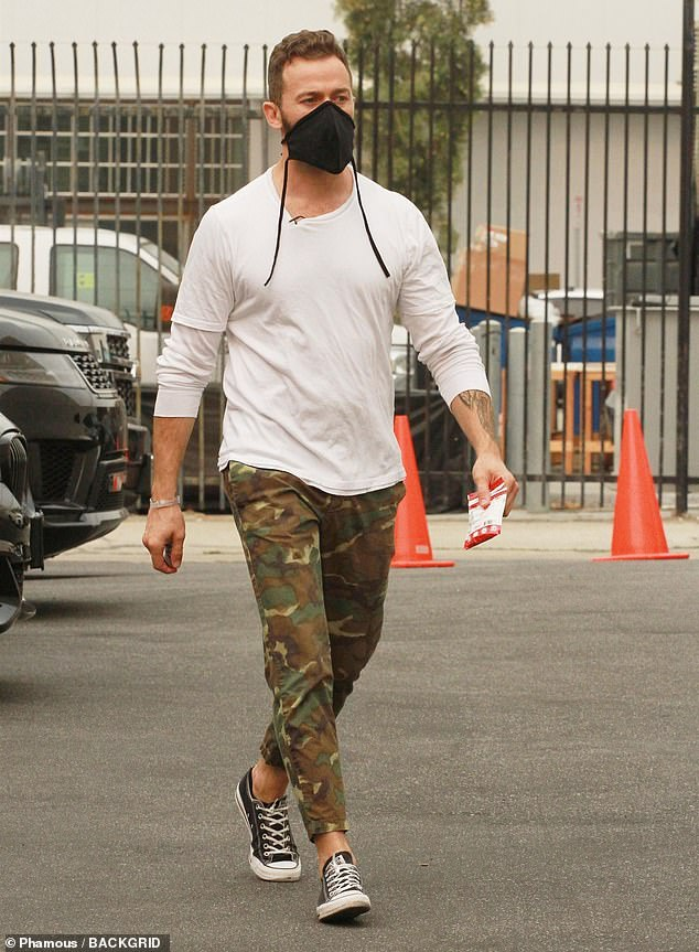 Keeping it cool: Kaitlin's rumored partner Artem Chigvintsev looked effortlessly cool in some camo print pants and a pair of black Converse All Star sneakers
