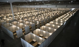 FILE - Cots fill Tecnopolis Park in Buenos Aires, Argentina, Friday, April 17, 2020. Authorities set up the field hospital in Buenos Aires. The space normally hosts museum exhibits, fairs and other attractions.