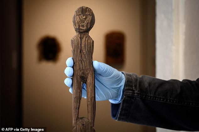 Teams recently uncovered a knotted string of plant fibers some 6,000 years old, an ancient wooden figurine,(pictured)  laced shoes with remains of a prehistoric man dating back to 2,800 BC, along with other lost treasures across the areas