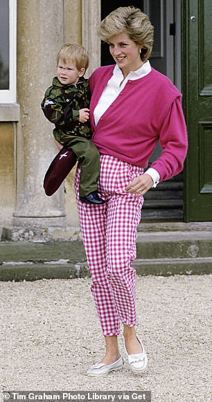Asimilarly attired princess carrying Harry in 1986