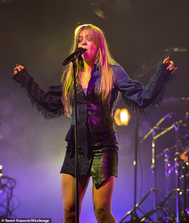 Funky!! When she lifted her arms during her performance, Becky revealed small tassels running down the length of both sleeves