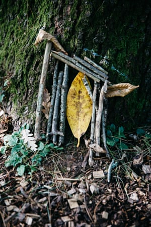 A small tree sculpture or fairy door built by a visitor at the base of a tree at Westonbirt