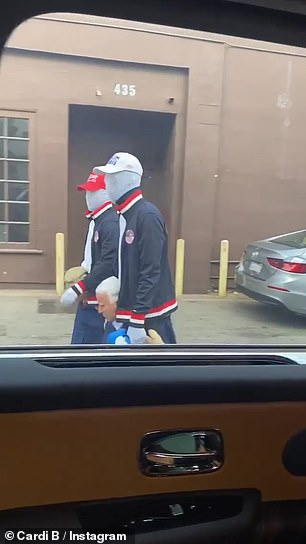 Close proximity: In her third and final clip, Cardi and her vehicle appeared to be parked on a side street as she remarked on how many alleged Trump supporters were 'walking around'