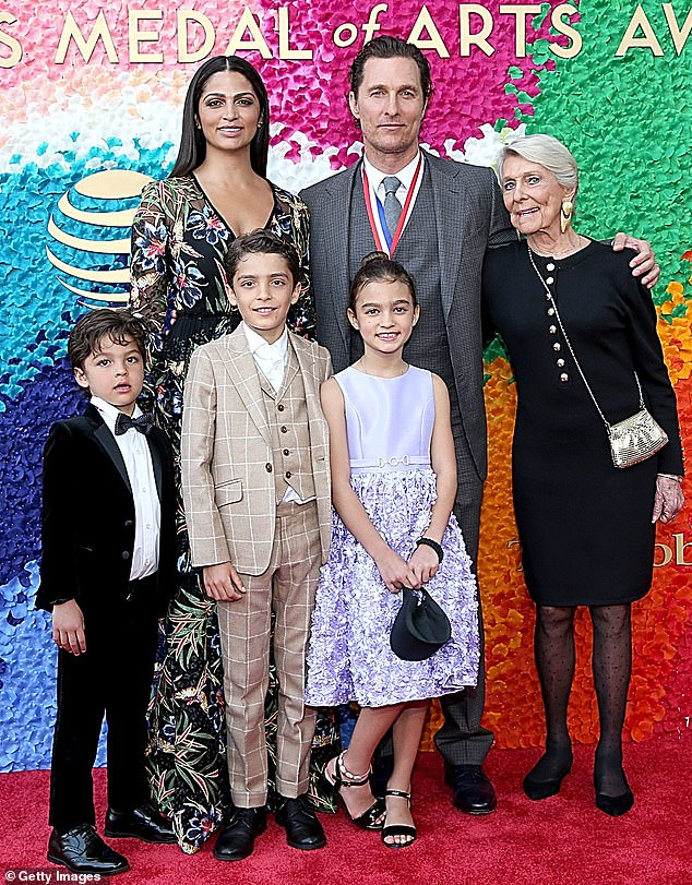 Family man: Matthew McConaughey is pictured with his wife Camila Alves, their three children, Levi, 12, Vida, 10, and Livingston, eight, and his mother Kay in 2019