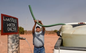 A livestock farmer in Arizona fills up a water tank for his animals to drink from last month. Once upon a time, rain water would have been sufficient.