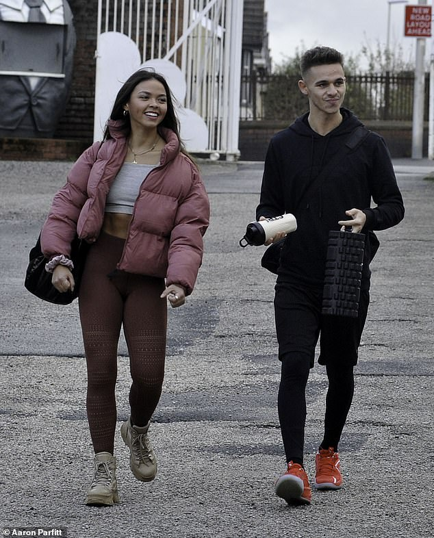 Wow! Dancing On Ice's Vanessa Bauer stunned as she showed off her toned abs in a grey crop top while heading to training with partner Joe-Warren Plant in Blackpool on Monday