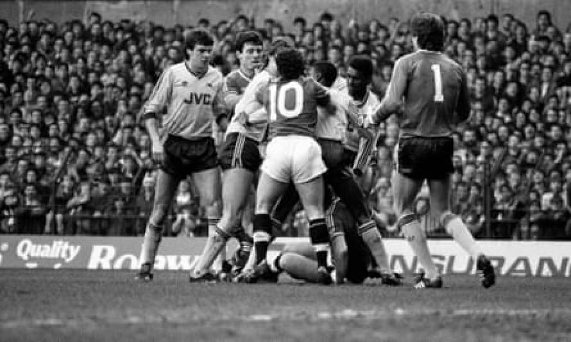 Terry Gibson (No10) has a frank exchange of views with the Arsenal players after a dangerous tackle from Norman Whiteside (on the floor)