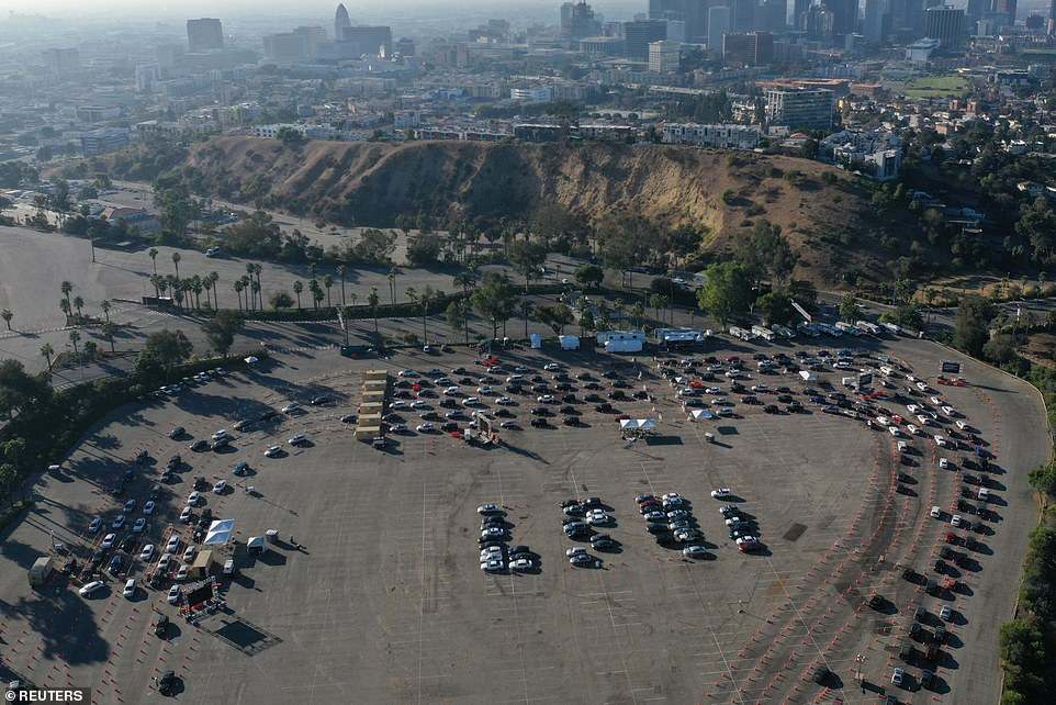 Hundreds of people in Los Angeles lined up on Friday at a COVID-19 testing site in the parking lot of Dodger Stadium as the number of cases and hospitalizations per day across the United States continued to hit record highs