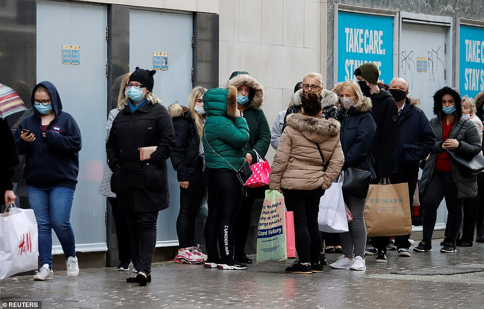 Despite the gloomy weather, shoppers queued outside a Primark store in Liverpool this morning