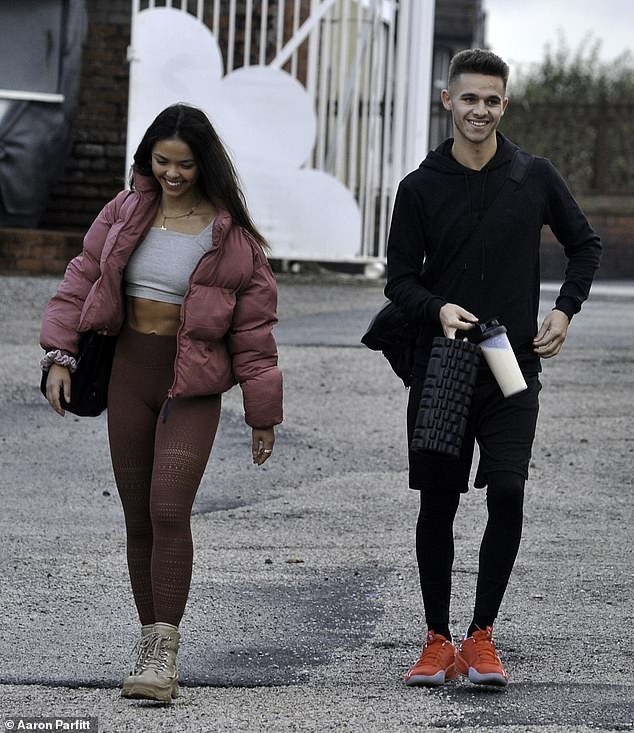 Ready to train: Joe-Warren, meanwhile, kept his look simple as he donned a black hoodie over a pair of black shorts and leggings for the training session