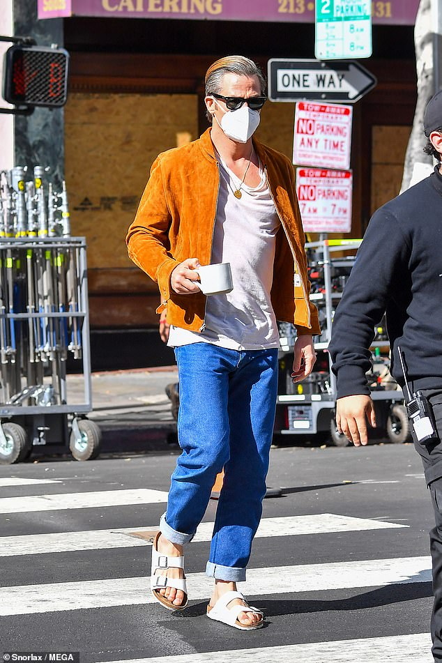 Arrivals: His co-star Chris Pine, 40, was also spotted sipping a coffee on set as he reported for filming, before shooting was 'called off' for safety reasons