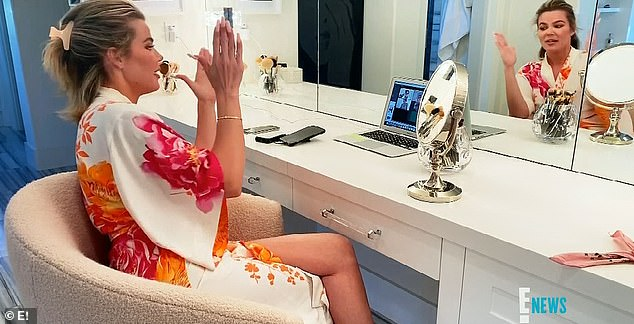 Makeup session:In a family call, Khloé did her eye makeup as everyone joked that she was getting dolled up for Tristan, or as Scott Disick, 37, called it, 'Pound town'