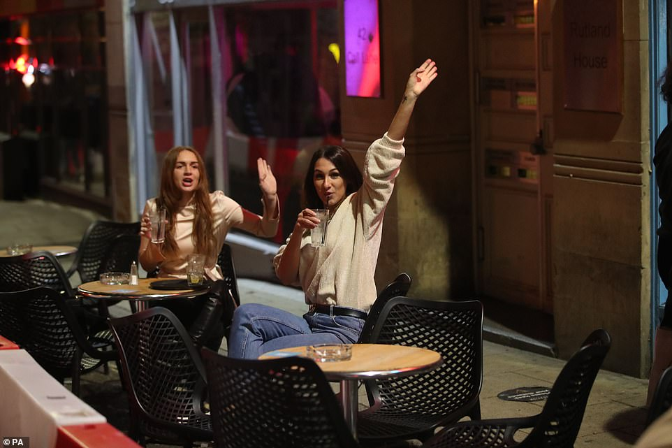 Drinkers in Leeds enjoying one last night out before the new national lockdown comes into force from midnight tonight