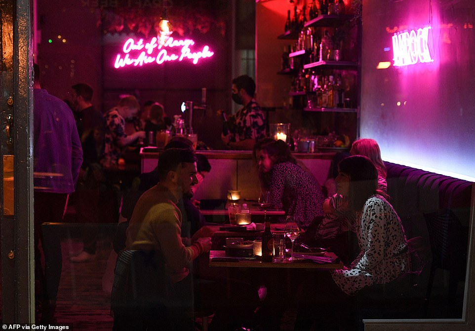 Customers enjoy drinks inside a bar in Leedson the eve of a secondlockdown in an effort to combat soaring infections