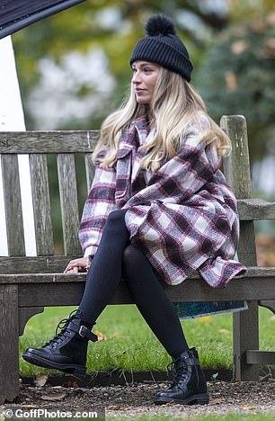 Pensive: Despite a tumultuous end to their relationship, Zara managed a small smile