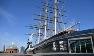 The domed entrance to the Greenwich Foot Tunnel, next to the Cutty Sark , with Canary Wharf in the background.