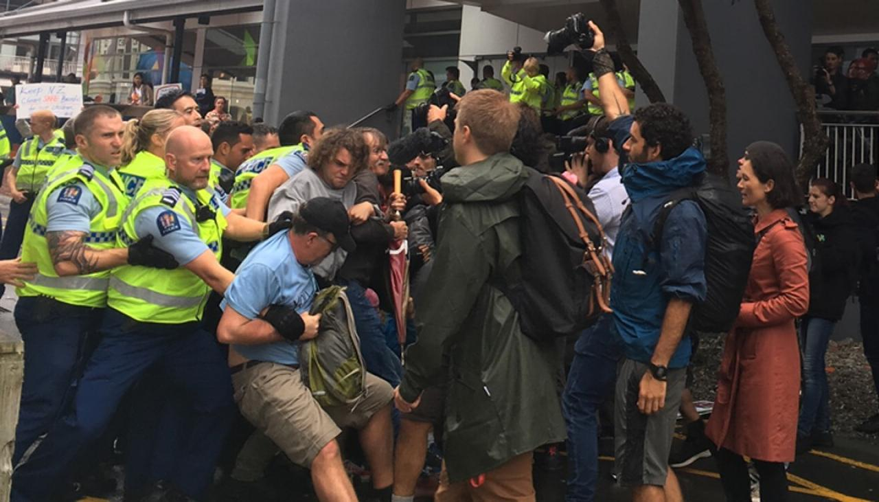 Four arrested at protest outside oil and gas conference
