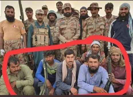 Major Nadeem Abbas Bhatti (standing in centre) with members of his 'Death Squad' (encircled in red). These 'Death Squad' members are seated with weapons supplied by the Pakistan Army. Two men (seated second from left and on extreme right) are holding Pakistan Army issued H&K G3 Rifles while another person (seated second from right) is armed with an H&K MP5 sub-machine gun.