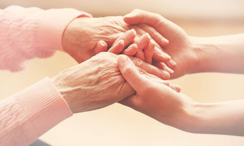 bigstock-Helping-hands-care-for-the-el-79739062