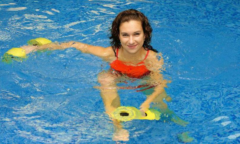 bigstock-Woman-In-Water-With-Dumbbels-3896769