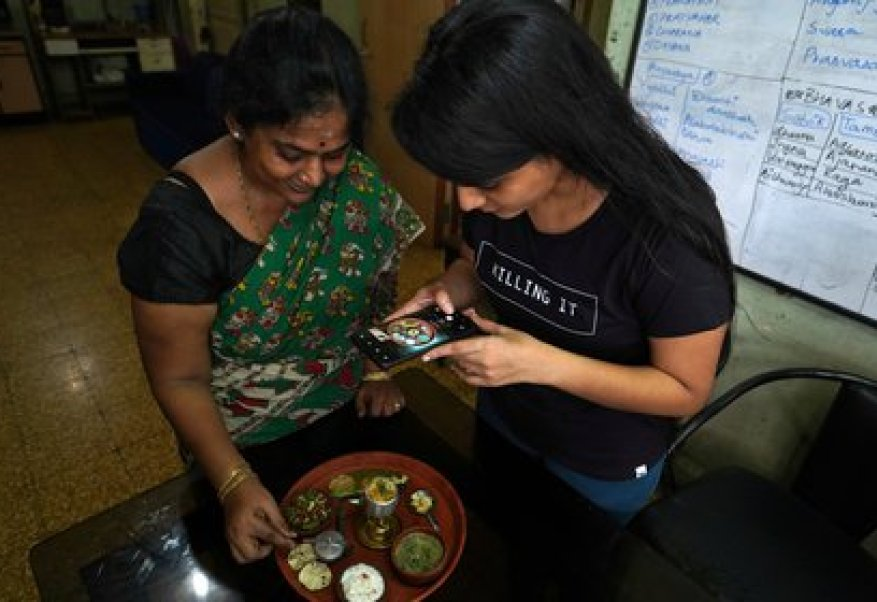 Geetha Sridha, 54, who used to post several videos a day on TikTok, records while cooking with her daughter. He says he will start publishing in another app (Reuters)