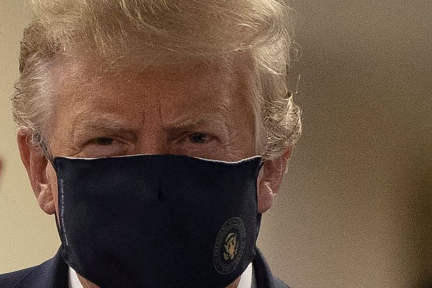 President Donald Trump wears a face mask for the first time in public