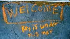 Welcome mat image by Flickr user alborzshawn