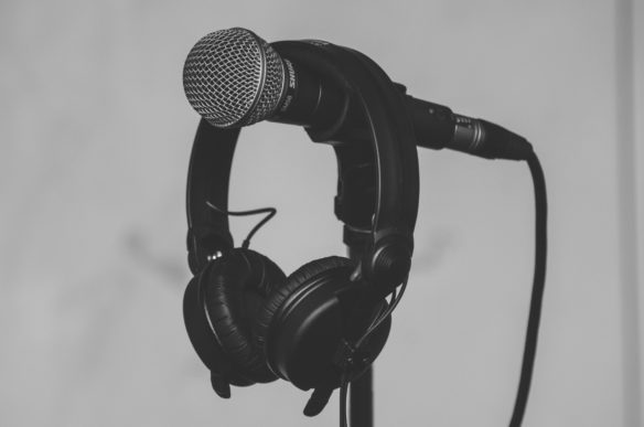 Photo by Barthy Bonhomme from Pexels https://www.pexels.com/photo/black-headset-hanging-on-black-and-gray-microphone-185030/
