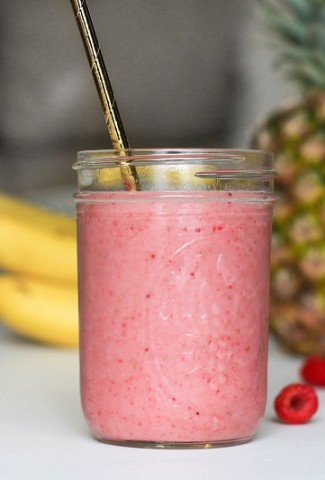 Healthy Banana Smoothie Recipes A Pink Smoothie with Bananas and Fruit In the Background