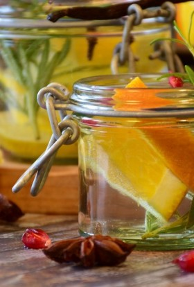Holiday Tea Recipes Jars of Water with Fruit and Herbs Inside