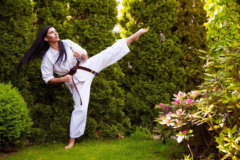 Herbalife24 Products Woman in a Gi Performing a High Kick
