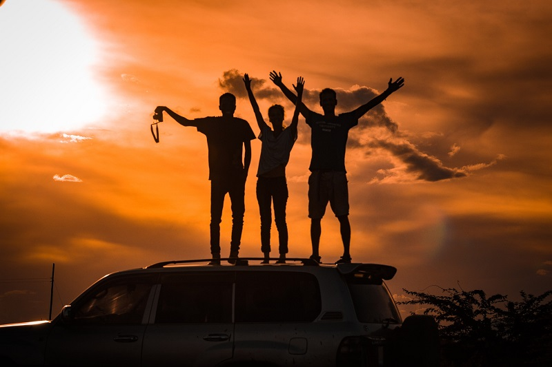 Herbalife Men's Health Product Benefits Three Men Standing On Top of a Hill With Their Hands in the Air